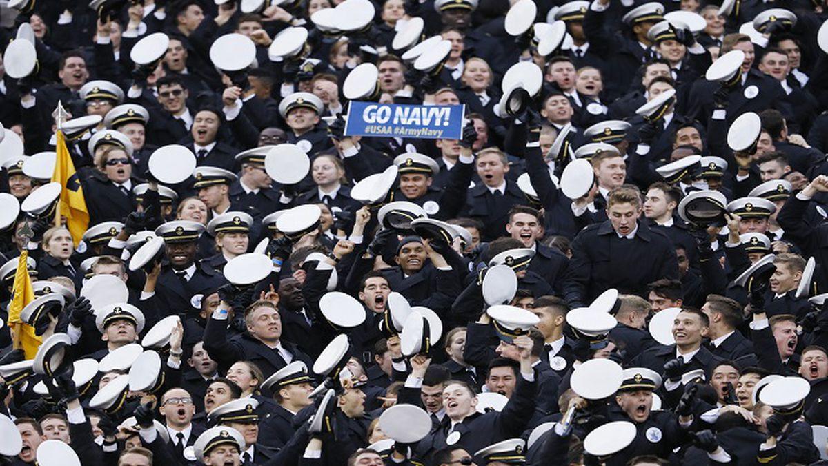 Navy midshipmen celebrate a touchdown during the first half of an NCAA college football game against Army, Saturday, Dec. 14, 2019, in Philadelphia. (AP Photo/Matt Slocum)