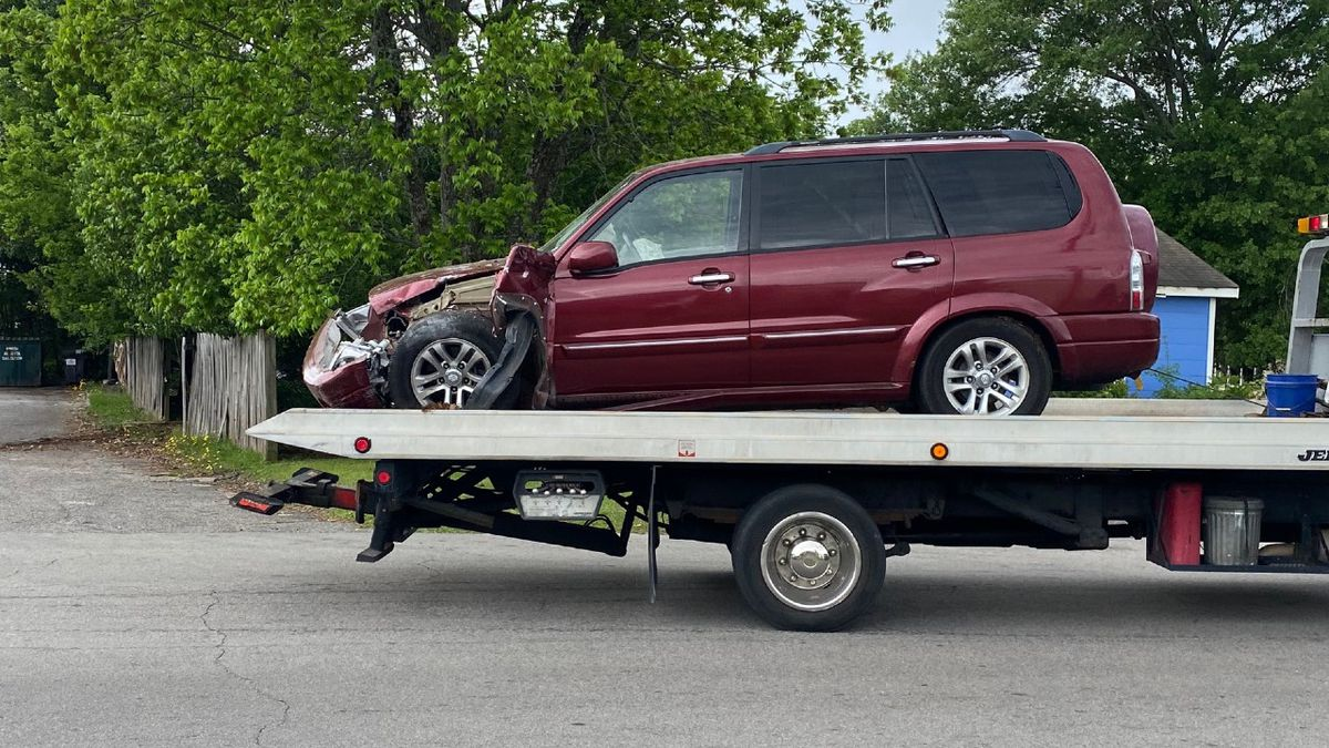 A heavily damaged vehicle is ready for towing after a three-vehicle crash where Edgefield Road...