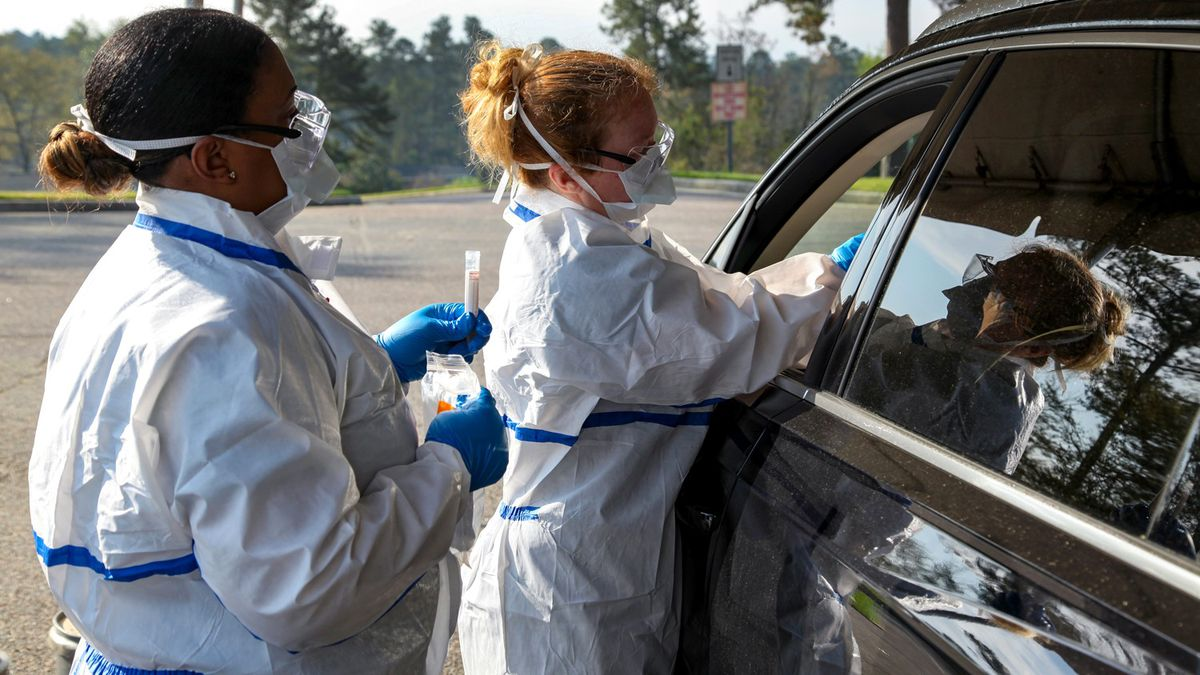 Savannah River Nuclear Solutions recently entered into a contract with nearby Augusta University Health to provide fast and reliable testing for coronavirus to benefit employees at the Savannah River Site. Lasha Kersey (left) and Stephanie Ward administer a test.