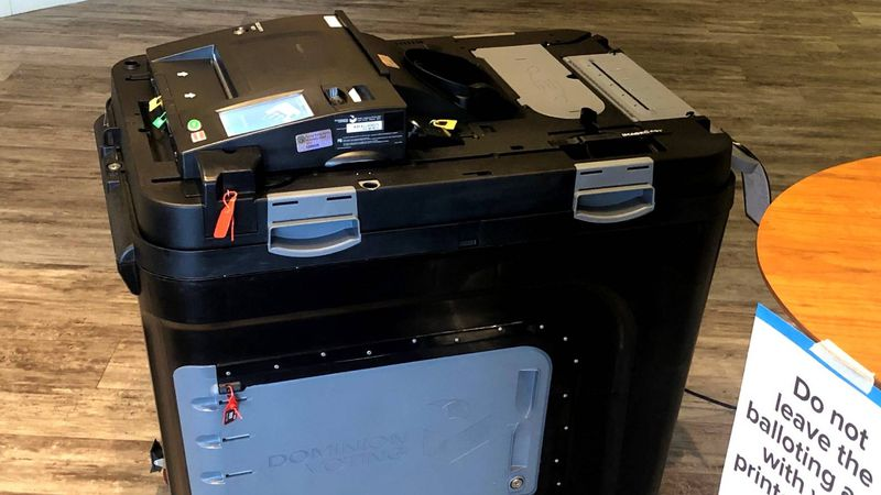 Hand-marked paper ballots at Stevens Creek Church went into a locked bin attached to this...
