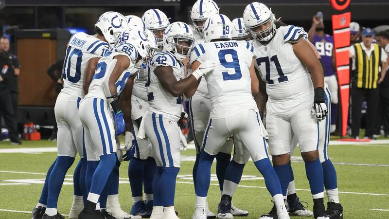 Indianapolis Colts quarterback Jacob Eason (9) calls a play in the huddle during the second...