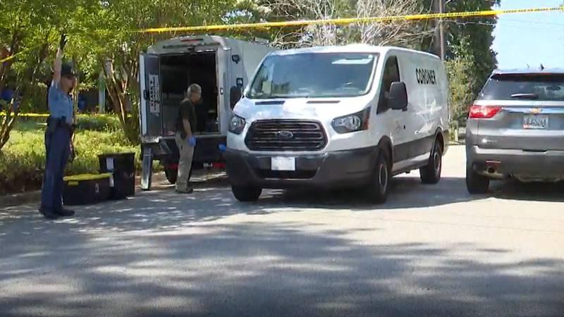 A coroner's van leaves the scene of an apparent murder-suicide in Evans on June 1, 2021.
