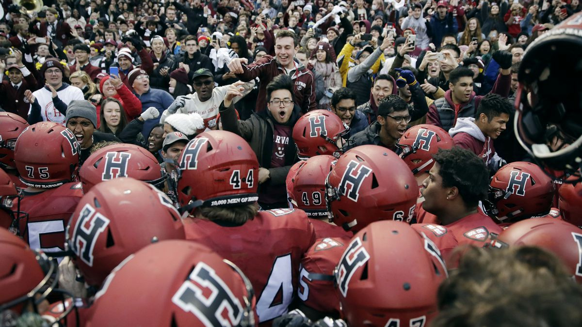 In this Nov. 17, 2018, file photo, Harvard players, students and fans celebrate their 45-27...