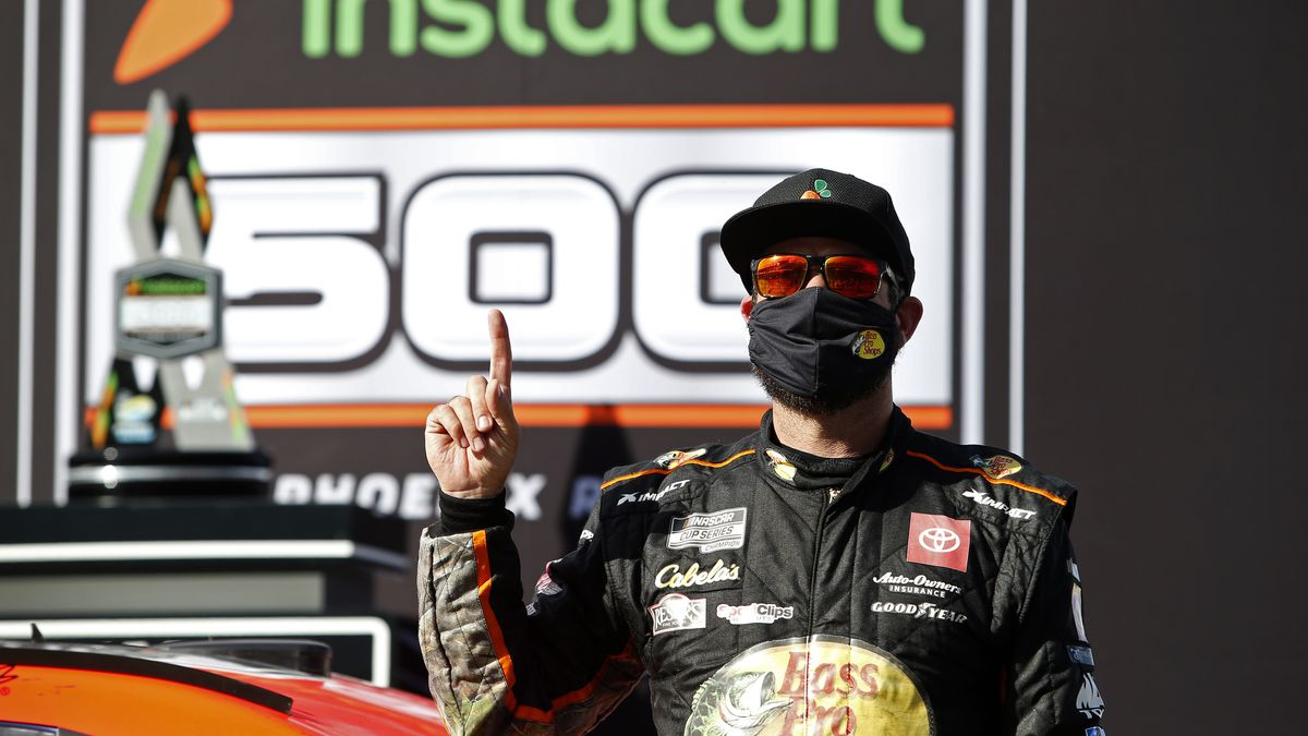 Martin Truex Jr. celebrates in Victory Lane after winning a NASCAR Cup Series auto race at...