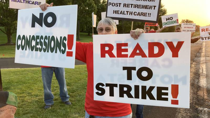 Union members hold an informational picket outside of John Deere Headquarters Tuesday morning.