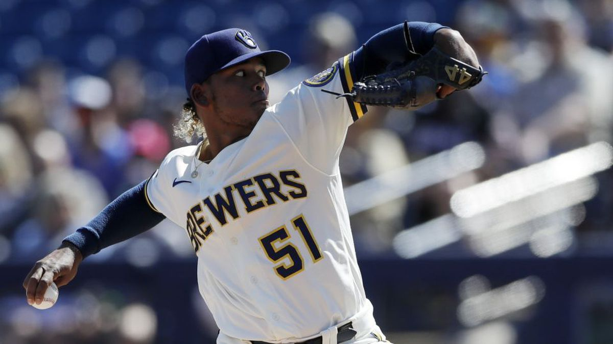 Milwaukee Brewers starting pitcher Freddy Peralta works against a Seattle Mariners batter during the first inning of a spring training baseball game Tuesday, Feb. 25, 2020, in Phoenix. (AP Photo/Gregory Bull)