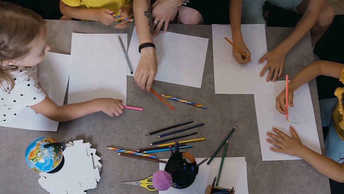 Children's hands learning from home