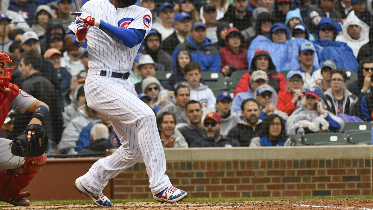 Chicago Cubs' Jason Heyward (22) hits an RBI single during the third inning of a baseball game...