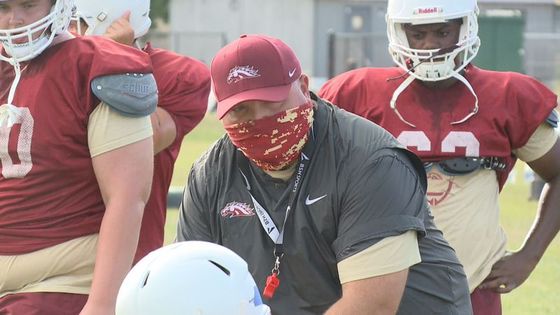 South Aiken Thoroughbred head coach Chris Hamilton works with the offensive line during practice.