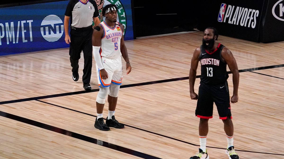 Referee Pat Fraher, left, and Oklahoma City Thunder's Luguentz Dort (5) look on as Houston...