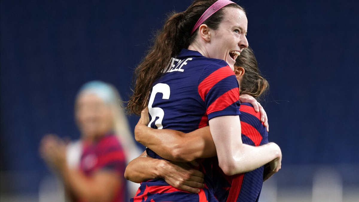 United States' Rose Lavelle, left, celebrates after scoring a goal during a women's soccer...