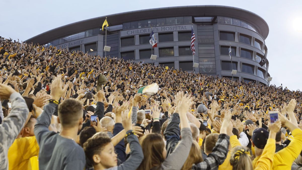 FILE - In this Saturday, Aug. 31, 2019 file photo, Iowa fans wave to children in the University...