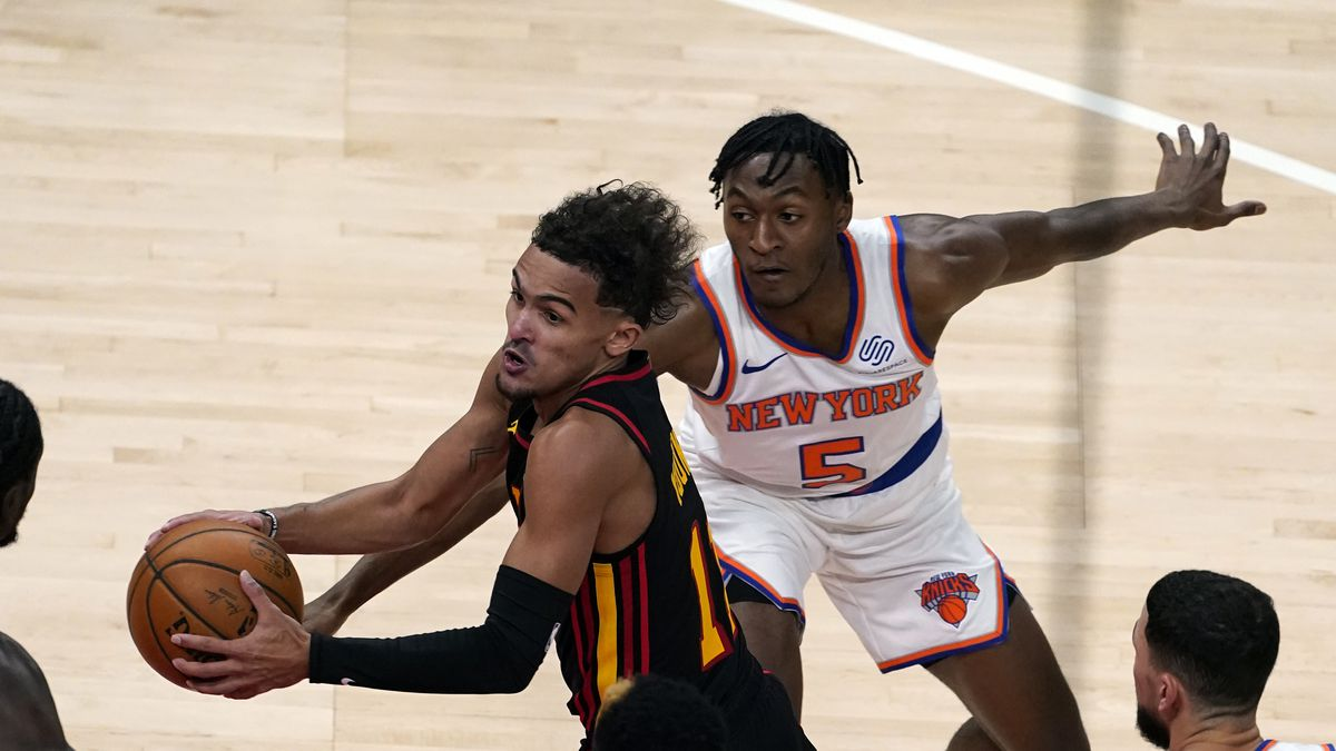 Atlanta Hawks guard Trae Young (11) looks to pass as New York Knicks guard Immanuel Quickley...