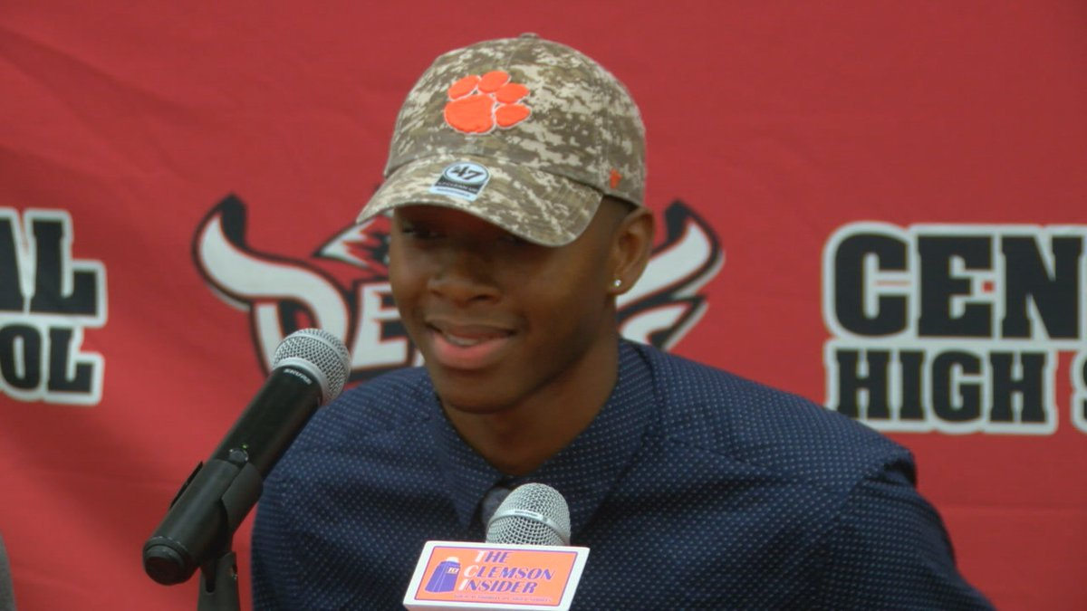 Central wide receiver E.J. Williams wearing a Clemson hat.