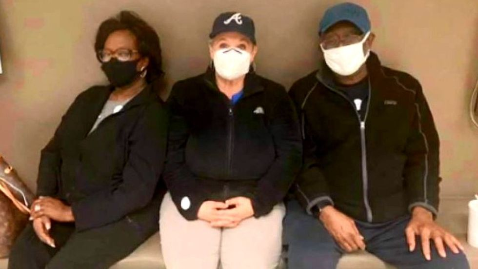 Tracy White shared this picture of her sitting with the parents of a patient who received one...