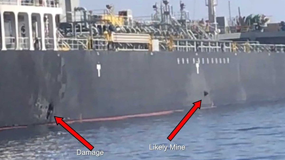 This June 13, 2019 image released by the U.S. military's Central Command shows damage and a suspected mine on the Kokuka Courageous in the Gulf of Oman near the coast of Iran. The U.S. military on Friday, June 14, 2019, released a video it said showed Iran's Revolutionary Guard removing an unexploded limpet mine from one of the oil tankers targeted near the Strait of Hormuz, suggesting the Islamic Republic sought to remove evidence of its involvement from the scene. (U.S. Central Command via AP)
