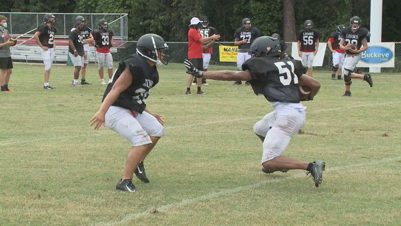 Augusta Christian's Terrence Vendiver puts out a stiff arm during a drill.