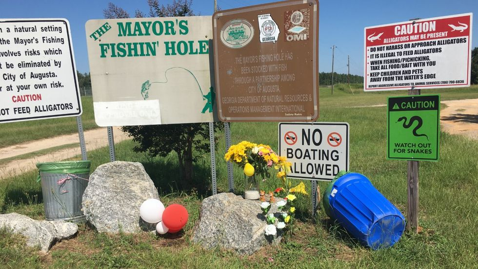 This impromptu memorial has sprung up at Mayor's Pond.