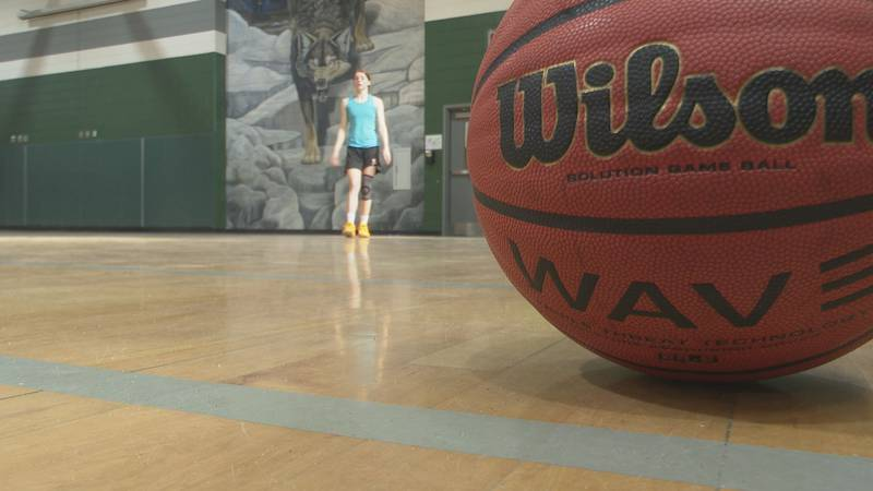 Evans Junior Caitlyn Burner practices with her AAU team in a limited capacity after...