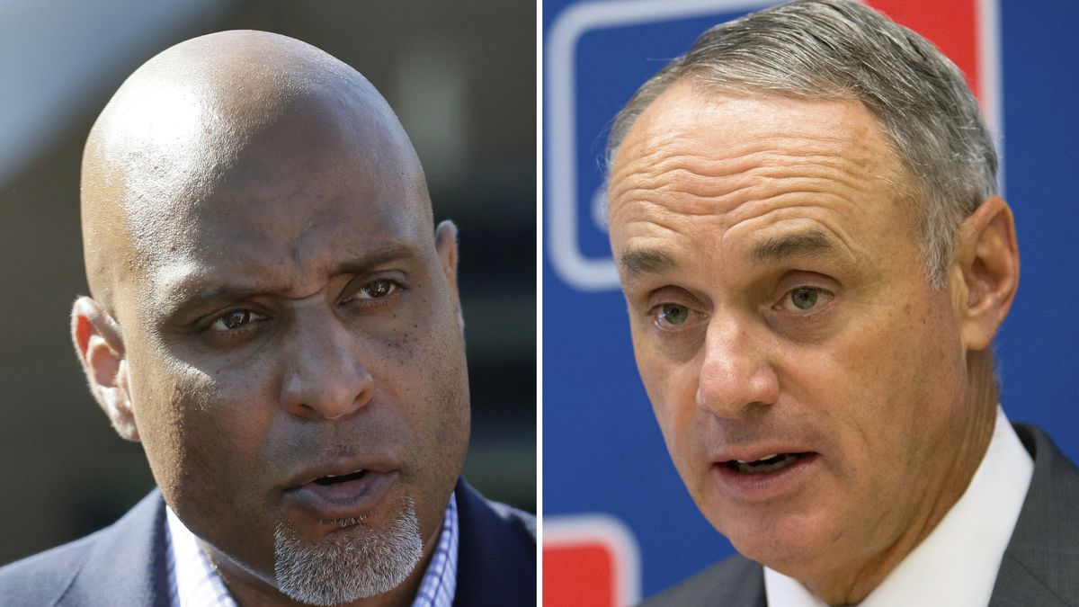 FILE - At left, in a March 17, 2015, file photo, Major League Baseball Players Association executive and former Detroit Tigers first baseman Tony Clark talks to the media before a spring training exhibition baseball game in Lakeland, Fla. At right, in a May 19, 2016, file photo, Baseball Commissioner Rob Manfred speaks to reporters during a news conference at Major League Baseball headquarters in New York. Negotiators for baseball players and owners are meeting this week in Irving, Texas, in an attempt to reach agreement on a collective bargaining agreement to replace the five-year contract that expires Thursday, Dec. 1, 2016. (AP Photo/File)