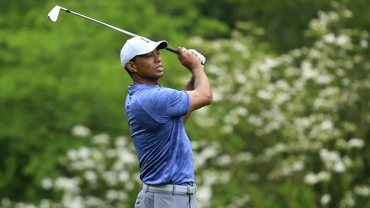 Masters champion Tiger Woods plays the No. 11 fairway during Practice Round 1 for the Masters...