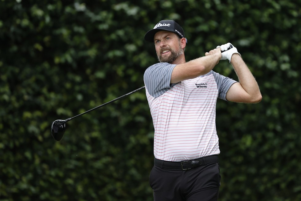 Webb Simpson plays his stroke from the No. 2 tee during Round 1 of the Masters at Augusta...