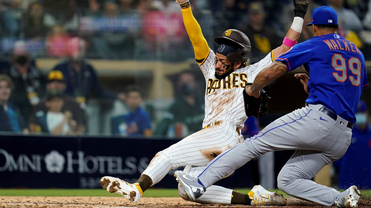 San Diego Padres' Fernando Tatis Jr. scores from third on a wild pitch by New York Mets ...