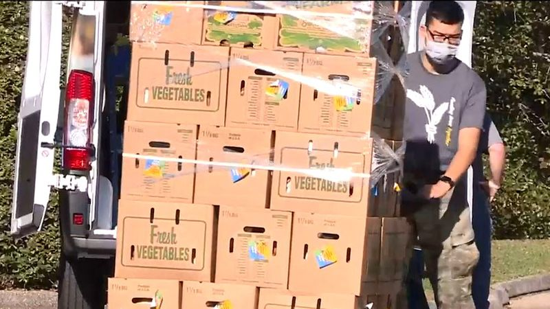 Vegetable are unloaded Nov. 21, 2020, for a Golden Harvest Food Bank giveaway in Grovetown.