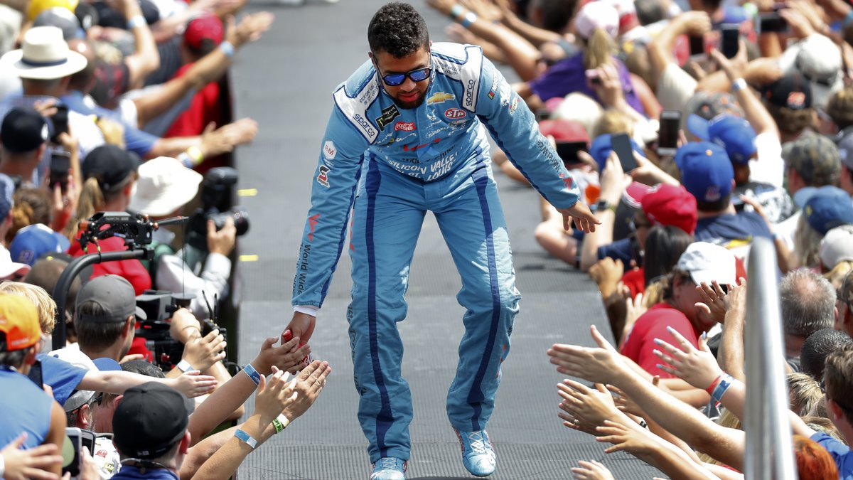 Bubba Wallace greets fans before a NASCAR Cup Series auto race at Michigan International...