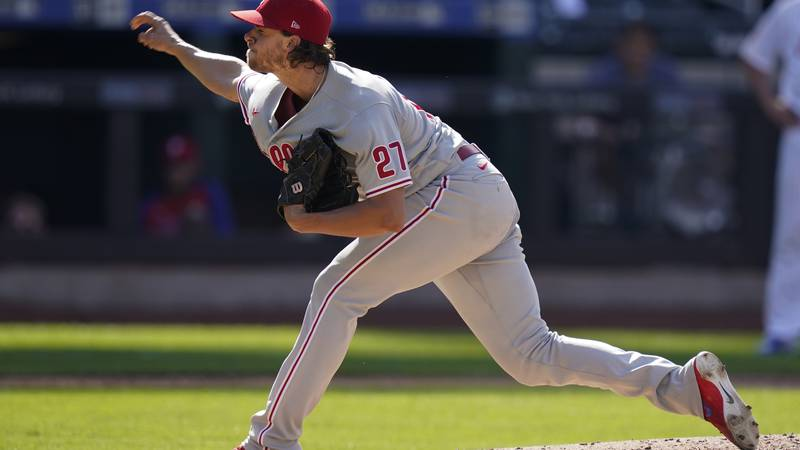 Philadelphia Phillies' Aaron Nola delivers a pitch during the third inning of the first...