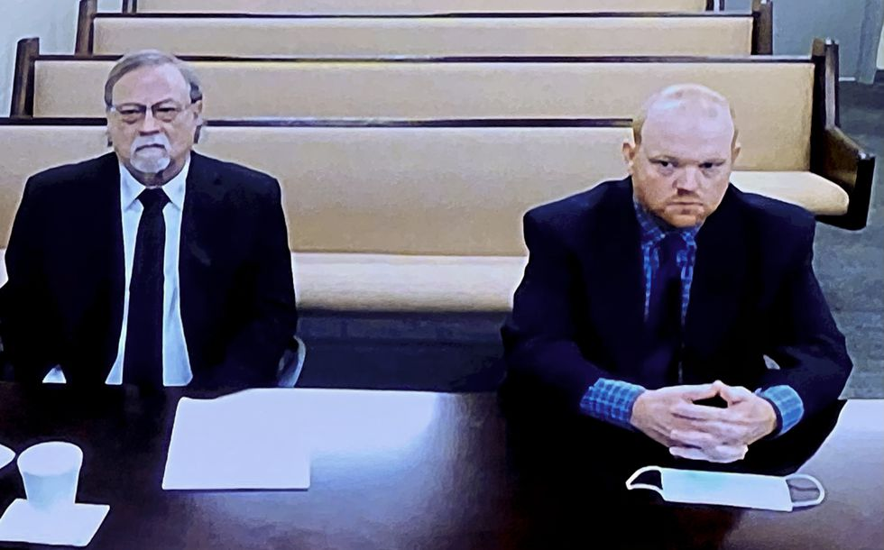 From left, father and son, Gregory and Travis McMichael, accused in the shooting death of...