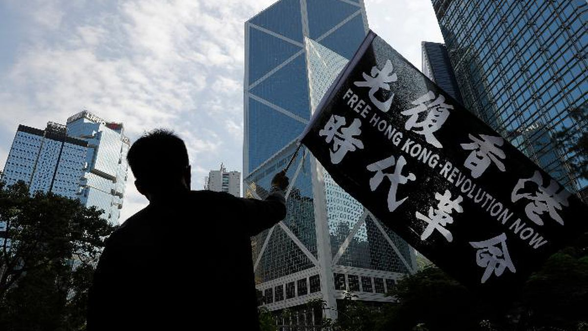 A pro-democracy supporter waves a flag during a rally by the advertising industry in Hong Kong on Monday, Dec. 2, 2019. Thousands of people took to Hong Kong's streets Sunday in a new wave of pro-democracy protests, but police fired tear gas after some demonstrators hurled bricks and smoke bombs, breaking a rare pause in violence that has persisted during the six-month-long movement. (AP Photo/Vincent Thian) (Source: Vincent Thian)