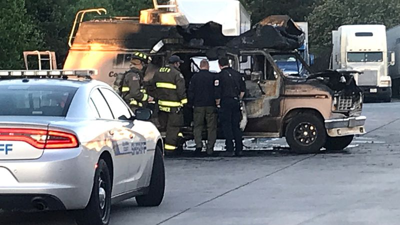 Authorities investigate a deadly vehicle fire early March 29, 2021, at the Pilot gas station at...