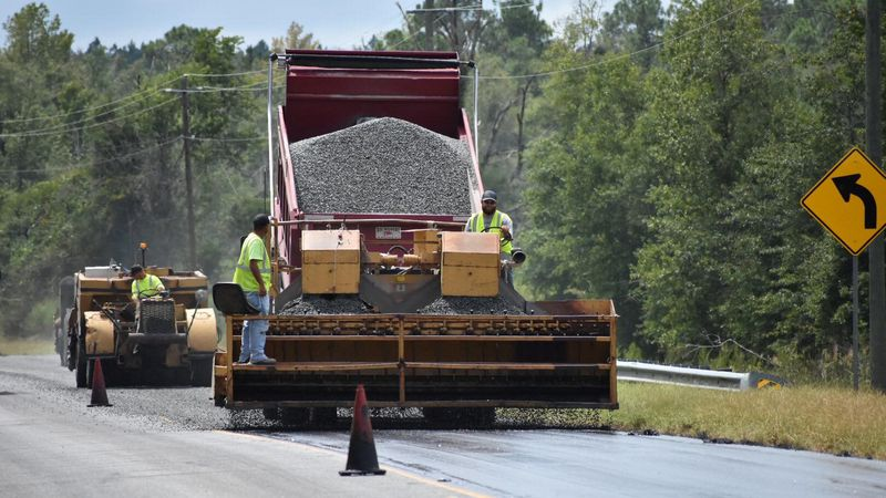 Georgia Department of Transportation crews are applying liquid emulsion and rock to State...