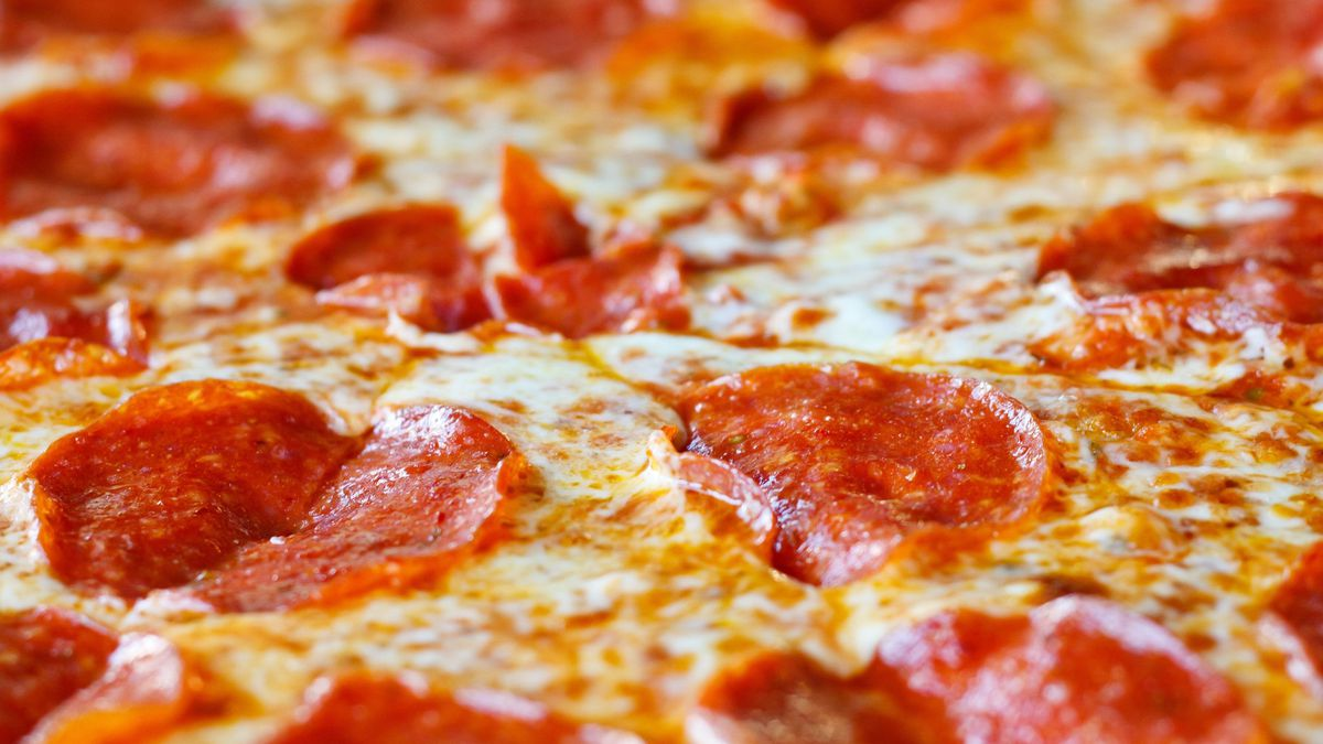 10589162 - a hot, cheesy, pepperoni pizza sliced and ready to eat