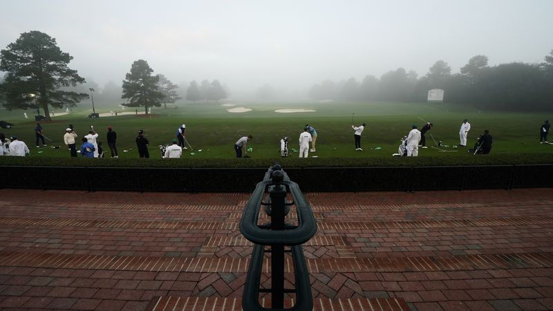 Golfers warm up on the Tournament Practice Facility during Round 4 of the Masters at Augusta...