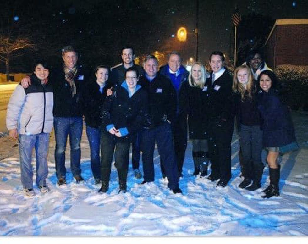 Members of the News 12 team gather outside the station to check out the snowfall.
