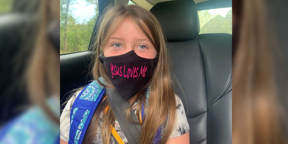 """Lydia Booth, 9, wore a """"Jesus Loves Me"""" face mask to Simpson Central Elementary School in..."""