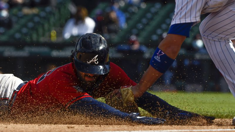 Atlanta Braves Dansby Swanson is tagged at third base by Chicago Cubs third baseman Kris Bryant...