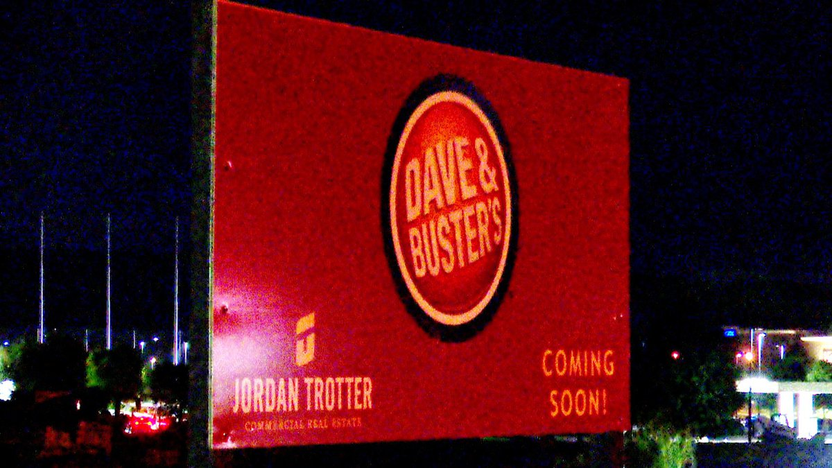 A sign heralds the new Dave and Buster's in Augusta.