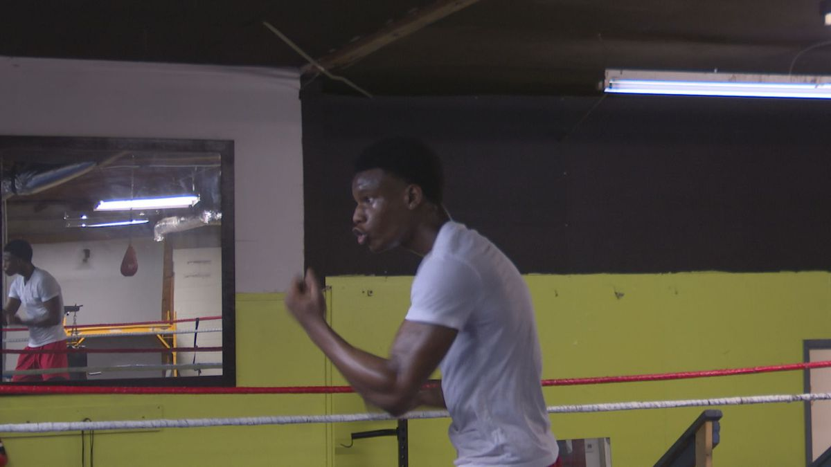 Augusta based boxer TiJay Parks shadow boxes during a training session while working with Paul...
