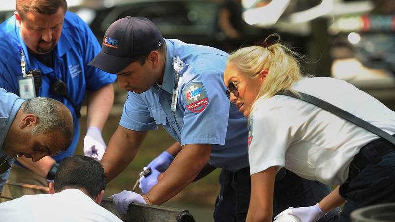 Paramedics and EMT members respond to one of three simultaneous drug overdose victims on the...