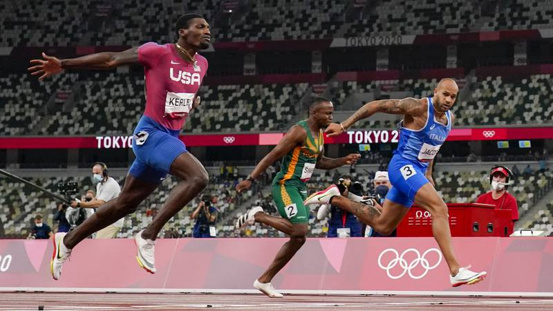 Lamont Jacobs, right, of Italy, wins the men's 100-meter final at the 2020 Summer Olympics,...