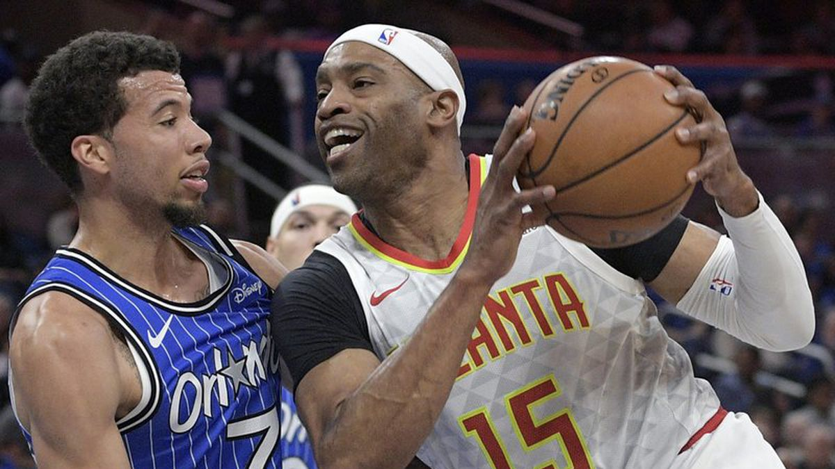FILE - In this April 5, 2019, file photo, Atlanta Hawks forward Vince Carter (15) drives to the basket against Orlando Magic guard Michael Carter-Williams (7) during the first half of an NBA basketball game in Orlando, Fla. Carter is returning to the Hawks for his 22nd season in the NBA. A league source confirmed that the 42-year-old Carter has agreed to terms with the Hawks. The person spoke on condition of anonymity because the deal had not been announced by the team. (AP Photo/Phelan M. Ebenhack, File)