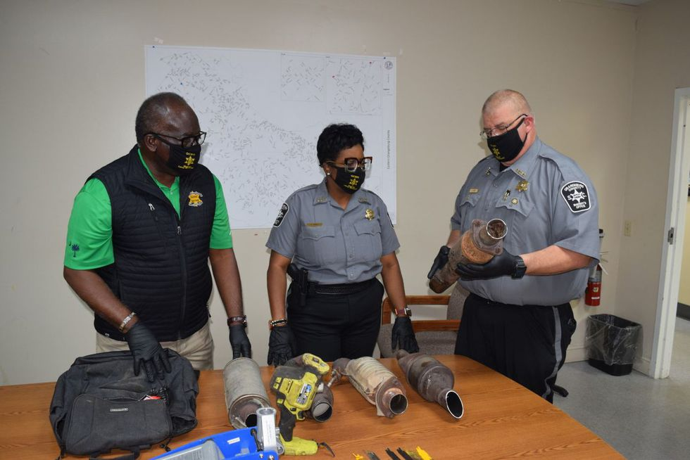Orangeburg County Sheriff's Office officials with the seized evidence.