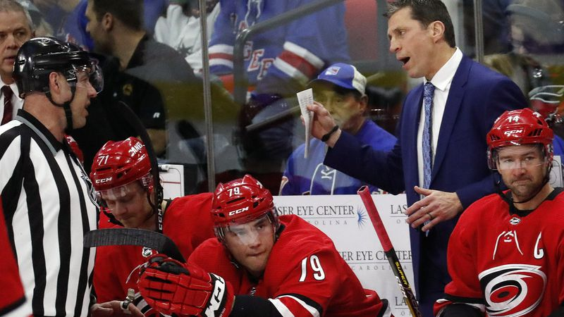 Carolina Hurricanes' head coach Rod Brind'Amour talks with an official during a break in the...