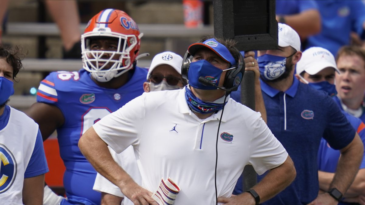 Florida head coach Dan Mullen looks at the scoreboard during the second half of an NCAA college football game against South Carolina, Saturday, Oct. 3, 2020, in Gainesville, Fla. (AP Photo/John Raoux,Pool)