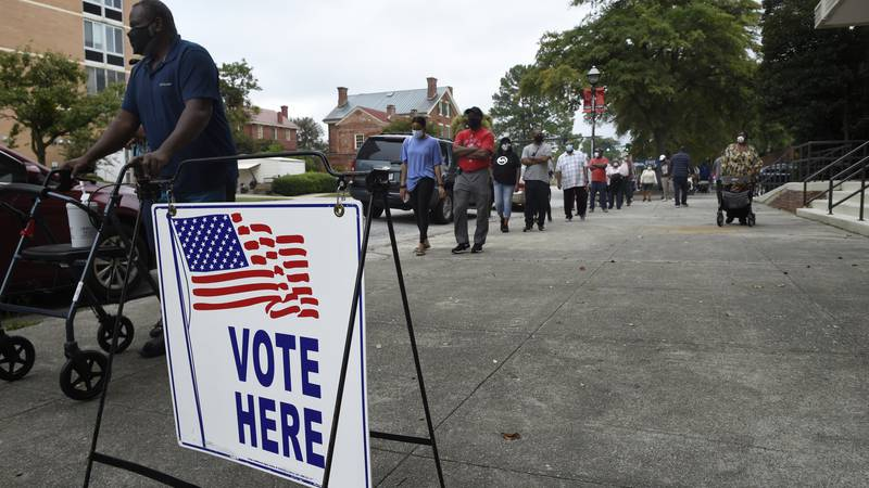 Monday was the first day for advance voting in Georgia and people showed up by the hundreds to...