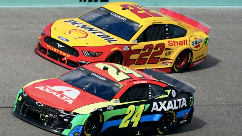 Joey Logano (22) and William Byron (24) battle for position during a NASCAR Cup Series auto...
