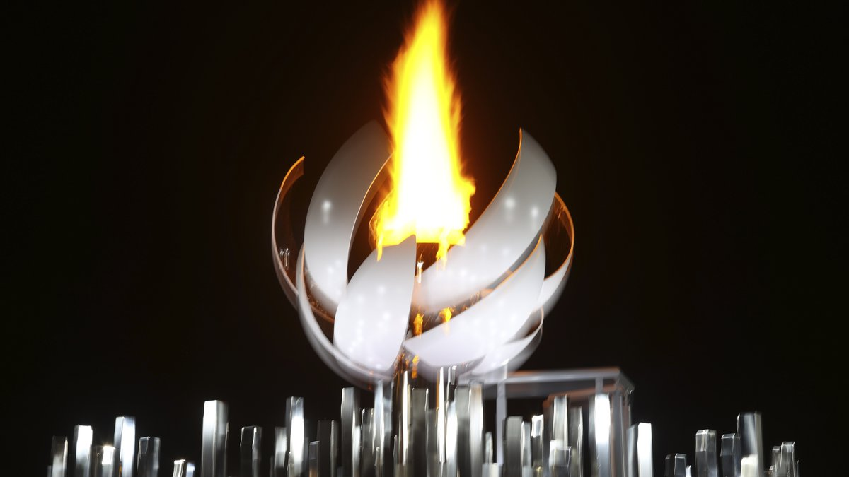 The Olympic cauldron gets lit at Yume no Ohashi bridge after the opening ceremony at the 2020...